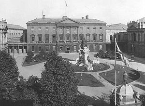 Monarchy of Ireland - Leinster House, Dublin, decorated for the visit of King George V and Queen Mary in 1911. Within a decade it was the seat of the Oireachtas of the Irish Free State.