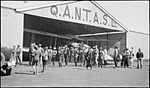 Les Holden's de Havilland DH61 Giant Moth biplane airliner G-AUHW 'Canberra' in a Qantas hangar is examined by crowd, Longreach, Queensland, 25 April 1929. (7974549837).jpg
