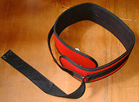 A lifting belt is sometimes worn to help support the lower back.