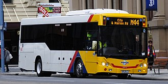 Light-City Buses - Custom Coaches bodied Scania K230UB on Currie Street in July 2014