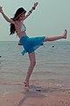 Lively model on a beach. (6784068391).jpg