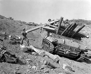 "Battle of Old Baldy - Personnel of the Korean Service Corps unload logs—for the construction of bunkers—from an M-39 Armored Utility Vehicle at the RHE 2nd US Inf Div supply point on ""Old Baldy"" near Chorwon, Korea."