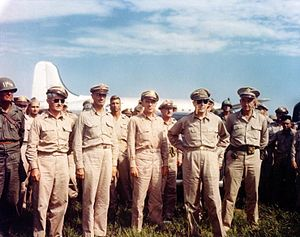 Joseph May Swing - General Douglas MacArthur, (second from the right), upon his arrival at Atsugi airdrome, near Tokyo, Japan, 30 August 1945. General Robert L. Eichelberger (right); Major General Joseph Swing (far left, wearing helmet).