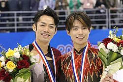Machida and Takahashi at the 2012 Cup of China.jpg