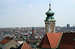 View across Vienna from the roof of Gerngross building: Part of Church of Mariahilf and tower of Apollo cinema.