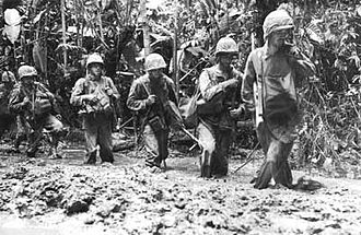 Battle of Piva Forks - Marines from the 3rd Battalion, 3rd Marines advance through the mud