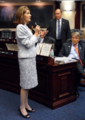 Marti Coley gestures while answering questions from colleagues on the House.png