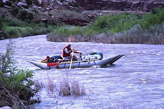 Max Coll - Max Coll on the Delores River below Slick Rock, Colorado, in 1997. Photo by Barry Massey.