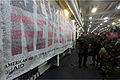 Members of the Royal Moroccan Armed Forces read a 9-11 commemorative banner on amphibious transport dock ship USS New York (LPD 21) during a tour of the ship for African Lion 12 April 11, 2012, in Morocco 120411-M-HF911-060.jpg