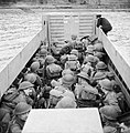 Men of 6th Battalion, the Black Watch crouch down in a landing craft as it approaches the shore, during combined operations training in Scotland, 17 November 1942. H25391.jpg