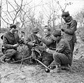 Men of the 2-7th Middlesex Regiment carry out maintenance on a Vickers machine gun at Anzio, Italy, 21 February 1944. NA12114.jpg
