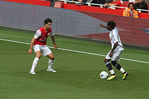 Nathan Dyer - Dyer attempts to get past Mikel Arteta.