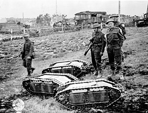 Military robot - British soldiers with captured German Goliath remote-controlled demolition vehicles (Battle of Normandy, 1944)
