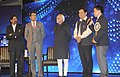 Mohd. Hamid Ansari presented the CNN-IBN Indian of the Year Award 2014 to the Shooter, Jitu Rai, in New Delhi. The Minister of State for Youth Affairs and Sports (Independent Charge), Shri Sarbananda Sonowal is also seen.jpg