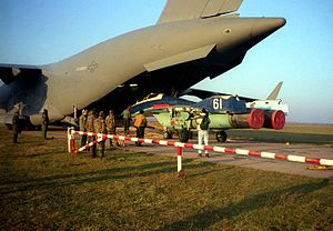 Armed Forces of the Republic of Moldova - A Moldovan MiG-29UB trainer on an American C-17 Globemaster III in 1997.