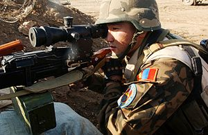 PK machine gun - Mongolian soldier with a PKM with a side-rail bracket mounted passive night sight (Polish 2.3× PCS-5)
