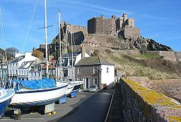 Mont Orgueil from pier with boats.jpg