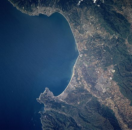 The Monterey Bay, as seen from space, stretches from Santa Cruz in the north to the Monterey Peninsula in the south Monterey Bay STS090-705-5.jpg