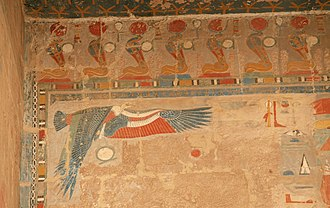 Eye of Ra - Frieze of uraei bearing sun disks at the top of a wall in the Mortuary Temple of Hatshepsut