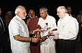 Narendra Modi being seen-off by the Governor of Kerala, Justice (Retd.) Shri P. Sathasivam and the Chief Minister of Kerala.jpg