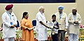 Narendra Modi giving away awards to the winners of national essay, painting and film competitions (1).jpg