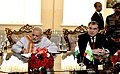 Narendra Modi signing the visitors' book at the India-Tajik Friendship Hospital, in Quarghan Teppa, Dushanbe, Tajikistan on July 13, 2015. The President of Tajikistan, Mr. Emomali Rahmon is also seen.jpg