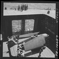 Navy crewmen aboard the USS Monterey (CVL-26) bringing an F6F to the flight deck on elevator. - NARA - 520750.tif