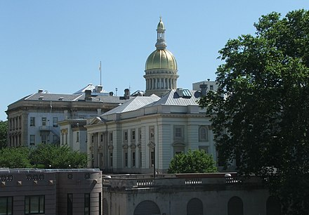 The New Jersey State House is topped by its golden dome in Trenton. New Jersey State House.jpg