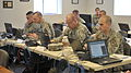 New York Army and Air National Guard officers and noncommissioned officers assigned to the Joint Operations Staff, work in an ad hoc Joint Operation Center during a Continuity of Operations exercise Joint Force 130328-Z-NU174-061.jpg