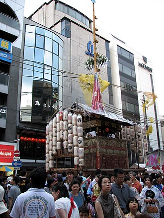 Gion Matsuri - Niwatoriboko float, one of the first to begin the parade. Festival-goers take turns getting on the float through a side building.