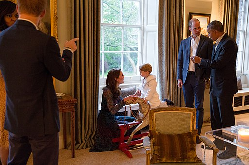 The Duke of Cambridge speaks to President Obama while the Duchess of Cambridge plays with Prince George; at left First Lady Michelle Obama talks with Prince Harry of Wales, at Kensington Palace in London April 22, 2016. - Obamas with the Royals (26515297651)
