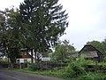 Old house at edge of Comanesti village - 2 - panoramio.jpg