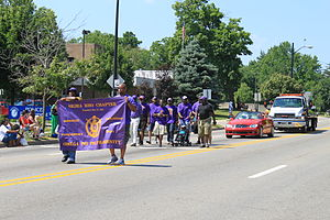 Omega Psi Phi - Omega Psi Phi chapter members marching in an Independence Day parade, Ypsilanti, Michigan