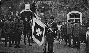 Ottoman soldiers displaying the captured standard of the Montenegrin force during the Siege of Scutari