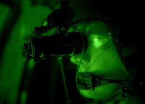 Night vision device - A U.S. Army aviator uses a pair of helmet-mounted AN/AVS-6 vision goggles. The effect on the natural night vision of the eye is evident