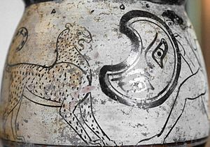 Peltast - A peltast fighting a panther. Side A from an Attic white-ground mug, early 5th century BCE. Louvre Museum, Paris.