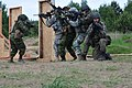 Paratroopers hold multinational breach training in Poland.jpg