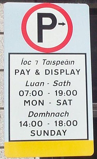 "Irish orthography - Íoc ⁊ Taispeáin (""pay & display"") sign in Dublin with the Tironian ''et'' for agus (""and"")."
