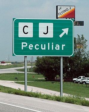 Peculiar, Missouri - Sign directing travelers to Peculiar