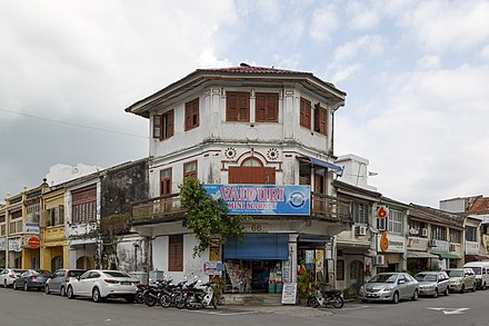 Shophouses in George Town's Little India sell Indian fabrics and textile, as well as Hindu prayer paraphernalia. Penang Malaysia Mini-market-corner-Lebuh-Gereja-and-Lebuh-King-01.jpg