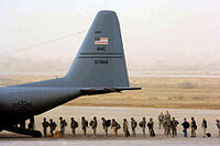 Personnel boarding a C-130 Hercules at Sather Air Base, Iraq.jpg