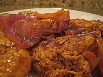 Adobo - Peruvian adobo chicken made from dried aji panca (yellow lantern chili, Capsicum chinense)
