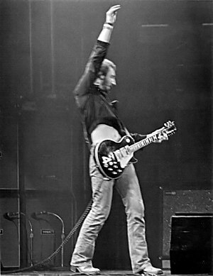 "Guitar chord - The Who's Peter Townshend often used a theatrical ""windmill"" strum to play ""power chords""—a root, fifth, and octave."