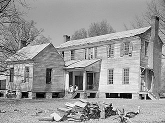 Boykin, Alabama - Rear view of the detached kitchen and former plantation home of the Mark Pettway family, called Sandyridge, in Boykin during April 1937. The house was demolished a short time later.  Photographed by Arthur Rothstein.