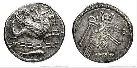 Silver coin minted in Tyre, dated 347-346 BCE, on the left Melqart riding on a maritime horse and on the right an owl with an Egyptian scepter PhoenicianSilverCoinTyre MelqartDolphin 347-346 BNF-Gallica.jpg