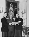 Photograph of President Truman at the White House with two members of the U.S. Marine Corps band. - NARA - 200409.tif