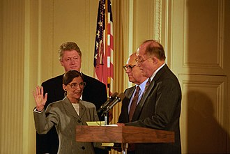 Ruth Bader Ginsburg - Chief Justice William Rehnquist swears-in Ginsburg as an Associate Justice of the Supreme Court as her husband Martin Ginsburg and President Clinton watch.