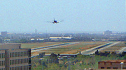 Plane landing san jose international airport runway 30r.jpg