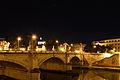 Ponte Vittorio and Dome of Saint Peter's at night.jpg