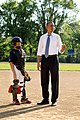 President Barack Obama prepares to throw a pitch during a surprise stop to greet members of the Northwest Washington Little League baseball teams at Friendship Park in Washington, D.C.jpg